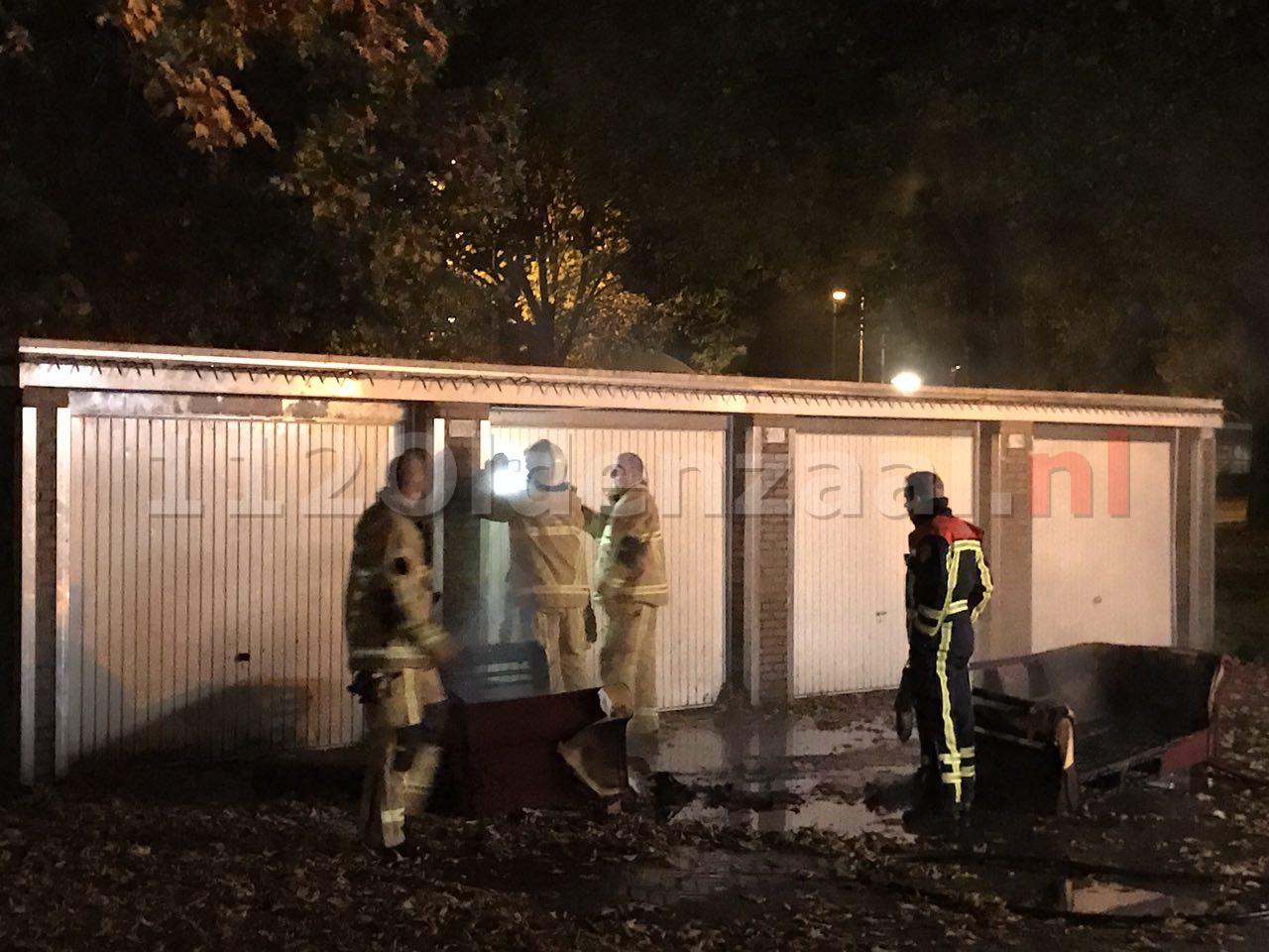 Foto 2: Brandend bankstel Enschede beschadigt garageboxen