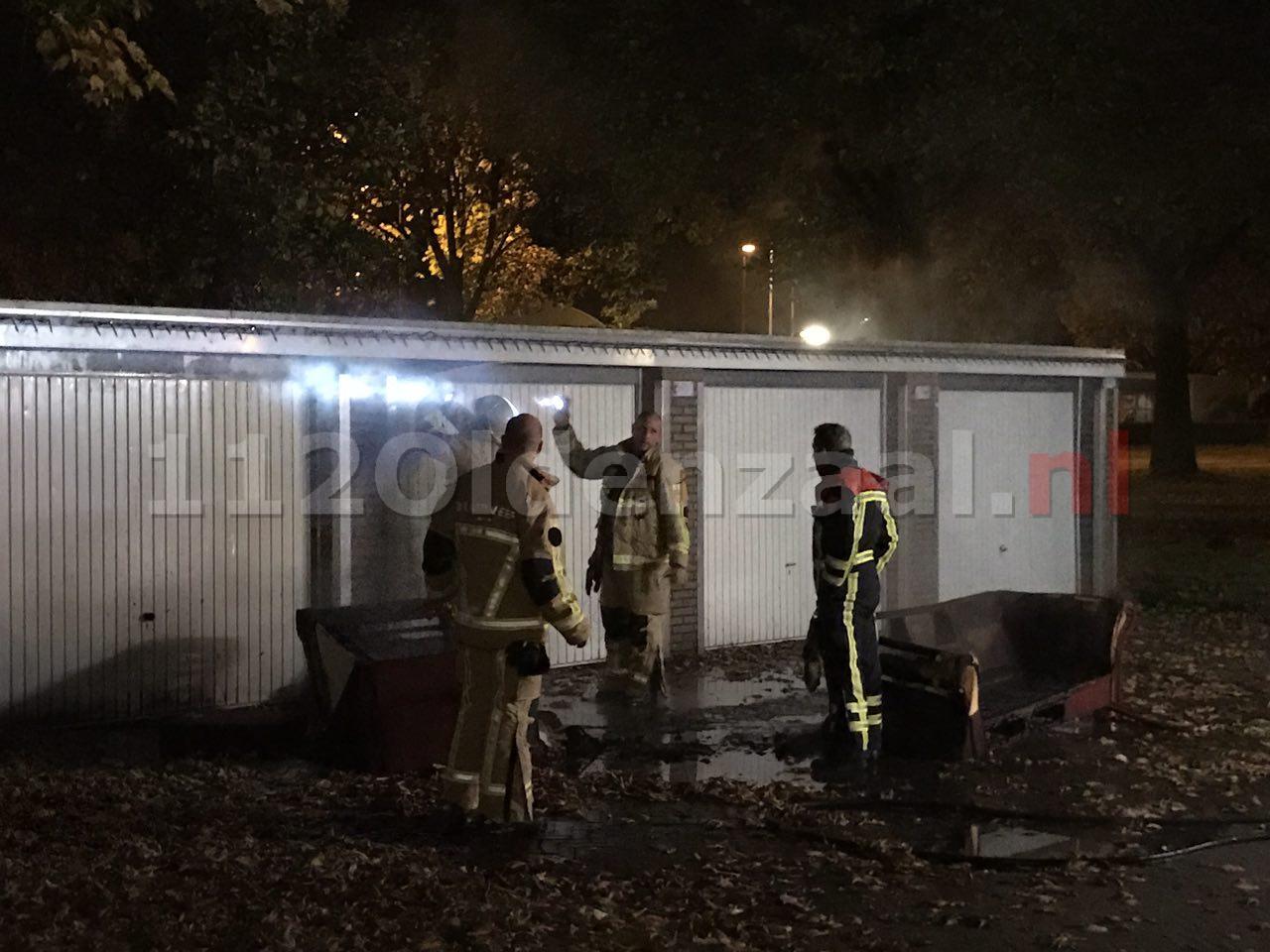 VIDEO: Brandend bankstel Enschede beschadigt garageboxen